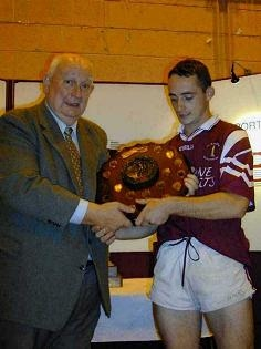 Philip McCone reciving All-Ireland 7's shield from GAA President Jack Boothman